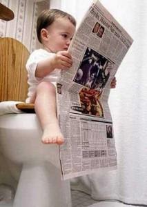 kid-sitting-in-toilet